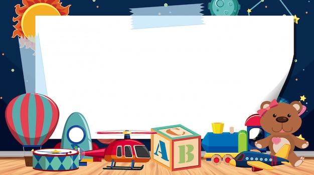 Modelo de fronteira com muitos brinquedos no chão