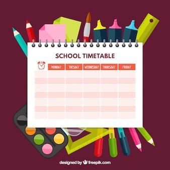 Modelo de horário escolar com canetas e lápis