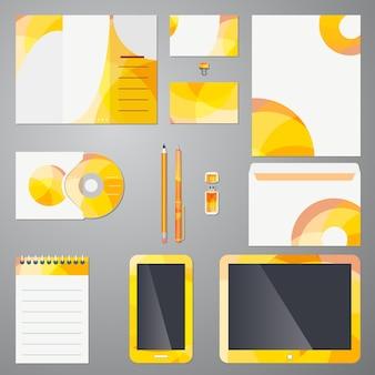 Modelo de identidade de marca em dispositivos móveis de papelaria e material de escritório com um padrão circular moderno colorido em amarelo e laranja