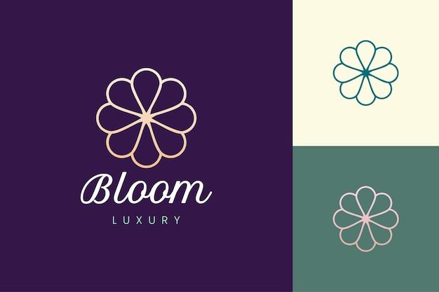 Modelo de logotipo de cuidados de beleza em formato de flor de luxo
