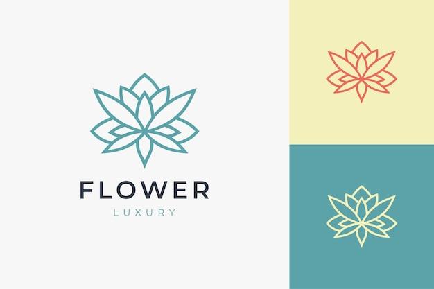 Modelo de logotipo de cuidados de beleza ou spa em forma de flor de lótus de arte