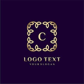 Modelo de logotipo de luxo (c) para sua marca com decoração floral