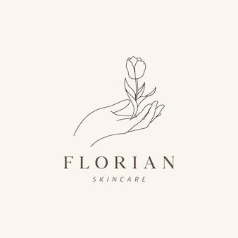Modelo de logotipo floral, mão skincare