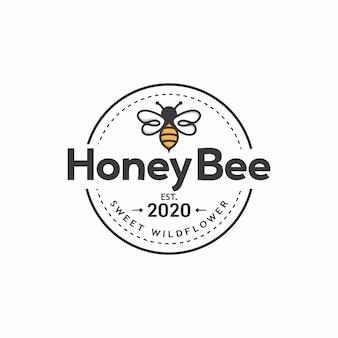 Modelo de logotipo vintage de abelha de mel