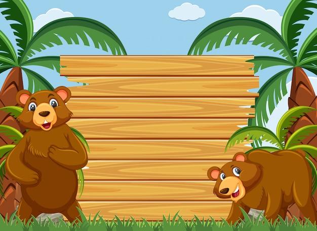Modelo de madeira com ursos pardos no parque