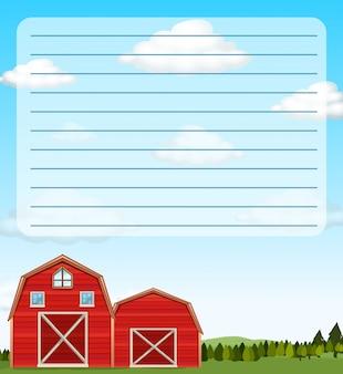 Modelo de papel com celeiros vermelhos no campo