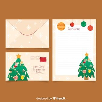 Modelo de papelaria de natal plana com árvore de natal