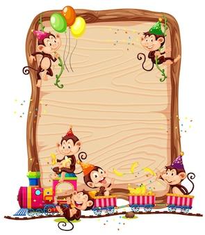 Modelo de placa de madeira em branco com macacos em tema de festa isolado