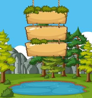 Modelo de sinais de madeira com muitas árvores no parque