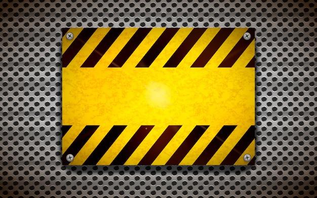Modelo de sinal de aviso em branco amarelo na grade metálica, fundo industrial