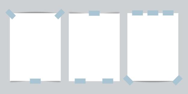 Modelo de três cartões de visita com fita adesiva em fundo cinza.