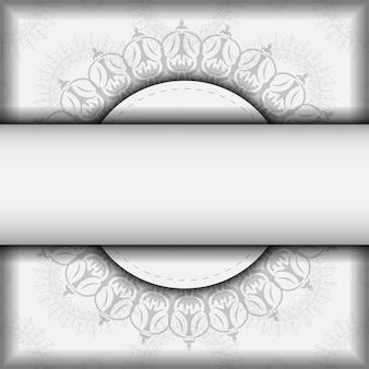 Modelo de vetor para cartões postais de design de impressão cores brancas com ornamento de mandala. preparar um cartão de convite com um lugar para o seu texto e padrões vintage.