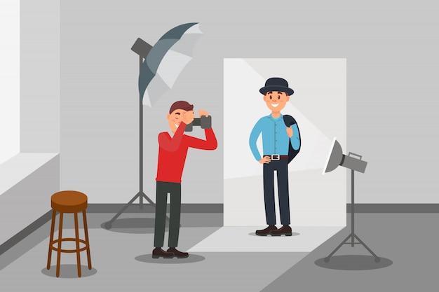 Modelo masculino em roupas da moda, posando na sessão de fotos, fotógrafo fazendo fotos, interior de estúdio de fotografia com equipamento profissional ilustração