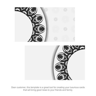 Modelo para design de impressão de cartões de visita cores brancas com mandalas. preparando um cartão de visita com um lugar para seu texto e enfeites pretos.