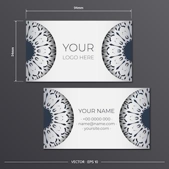 Modelo para impressão de cartões de visita de design cor branca com padrões vintage pretos. preparação de cartão de visita com ornamento grego.
