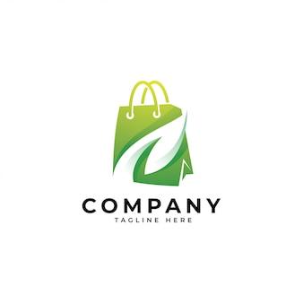 Moderna sacola de compras e logotipo de folha verde