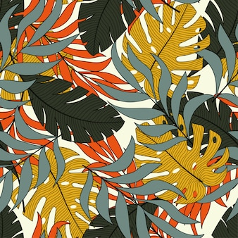 Moderno padrão tropical sem costura com plantas e folhas brilhantes de laranja e amarelas