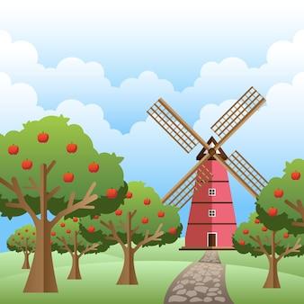 Moinho de vento na primavera com árvores em dia nublado