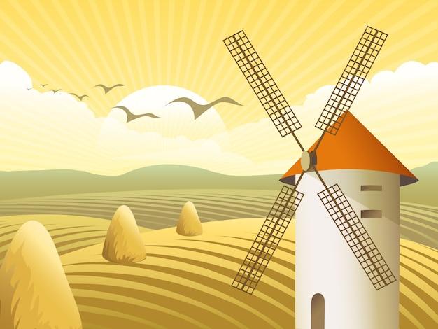 Moinhos de vento com telhado, em meio a campos e pilha de feno