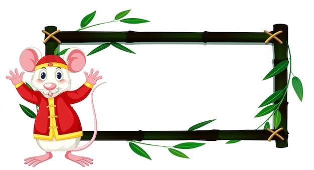 Moldura de bambu com rato branco em traje chinês