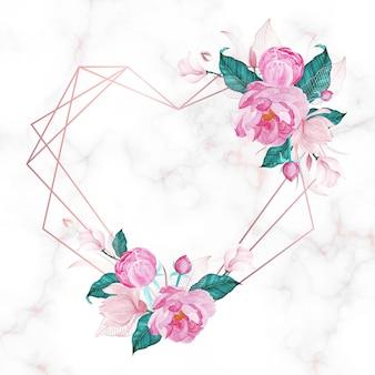 Moldura de coração de ouro rosa com floral em fundo de mármore.