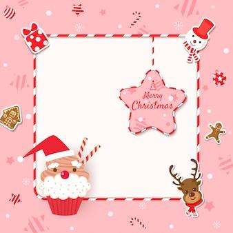 Moldura de feliz natal com cupcake e biscoitos para ornamentos em fundo rosa.