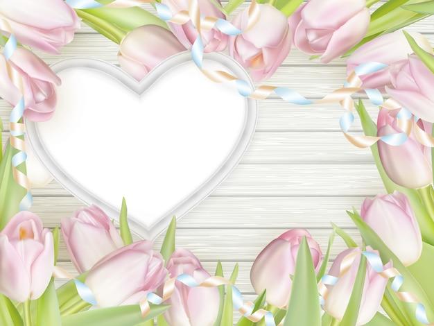 Moldura de forma de coração com tulipas.