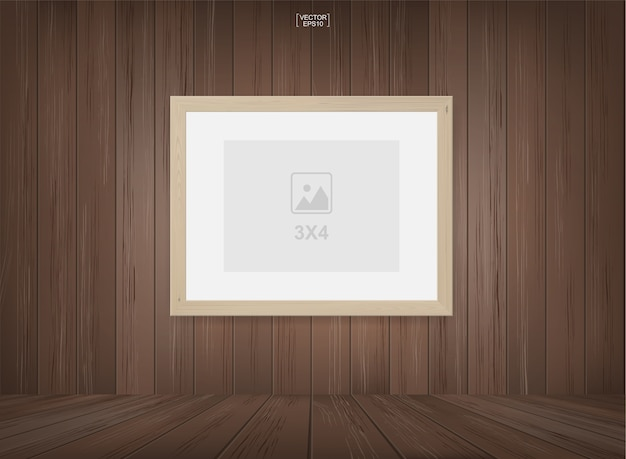 Moldura de foto vazia ou fundo de moldura de imagem no fundo do espaço da sala de madeira