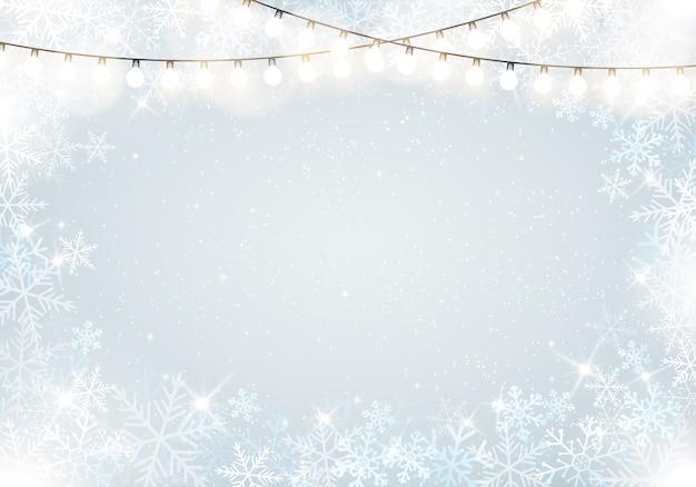 Moldura de inverno com flocos de neve e pendurar luzes de fada
