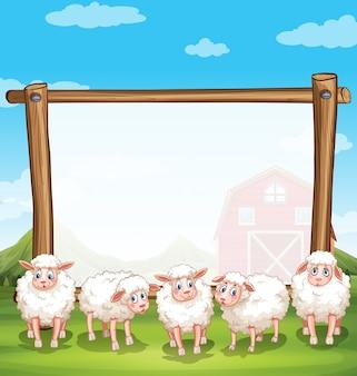 Moldura de madeira com ovelhas na fazenda