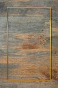 Moldura dourada em fundo de madeira grunge