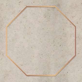 Moldura octogonal dourada sobre fundo de mármore marrom