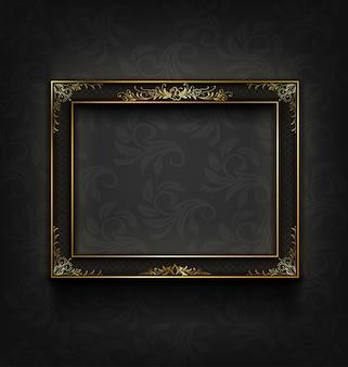 Moldura preta e ouro vintage na parede preta