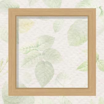 Moldura quadrada de madeira no fundo do padrão de folhagem