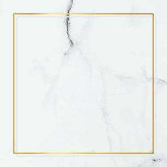 Moldura quadrada de ouro sobre fundo de mármore branco