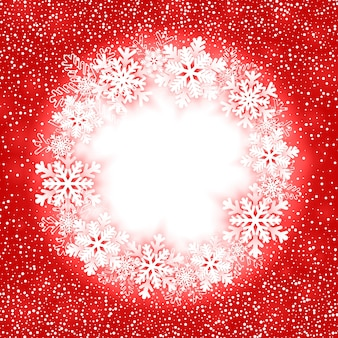 Moldura redonda de natal com flocos de neve.