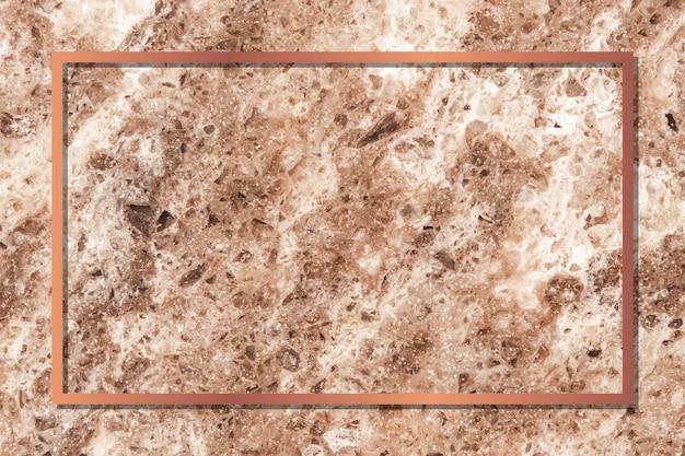 Moldura retangular de cobre em fundo de mármore marrom