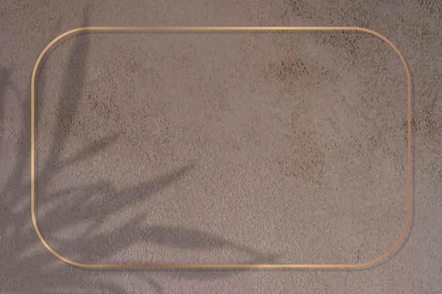 Moldura retangular de ouro em folha sombreada em fundo marrom