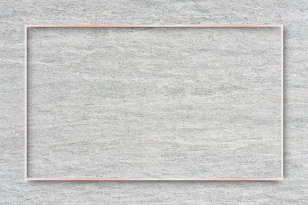 Moldura retangular de ouro rosa em vetor de fundo de cimento