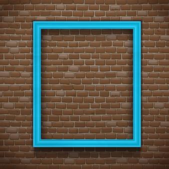 Moldura vazia azul no fundo da parede de tijolo