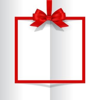 Moldura vermelha de férias com laço no fundo do livro.