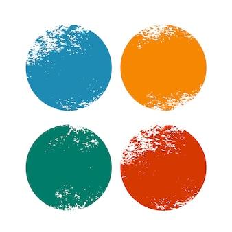 Molduras circulares desgastadas de grunge em quatro cores