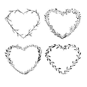 Molduras em forma de coração isoladas em branco molduras florais rústicas desenhadas à mão molduras românticas de vetor