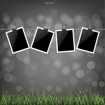 Molduras para fotos em branco no campo de grama para o fundo.