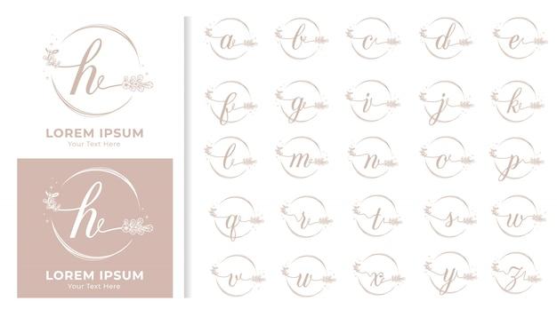 Monograma alfabeto decorativo luxuoso com molduras florais Vetor Premium