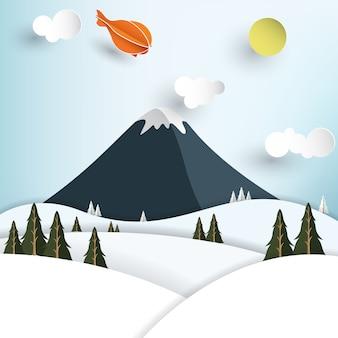 Montanha no inverno em estilo de arte de papel