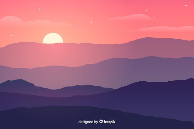 Montanhas de cores gradientes com sol brilhante