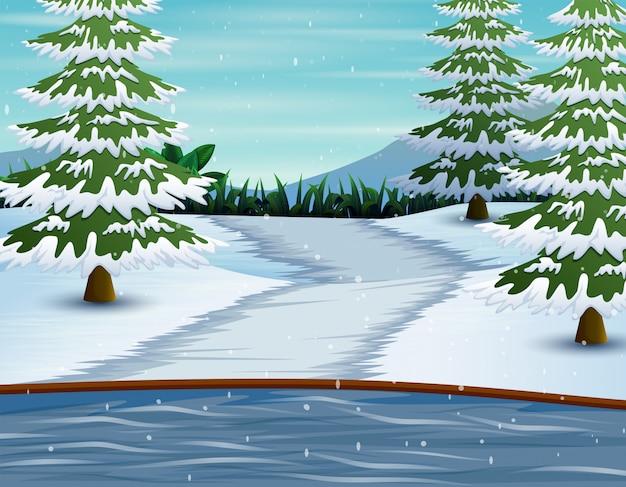 Montanhas de inverno e lago com pinheiros cobertos de neve