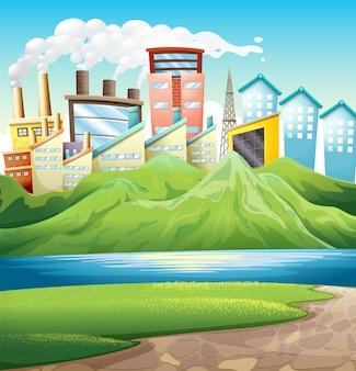 Montanhas verdes perto do rio e dos edifícios