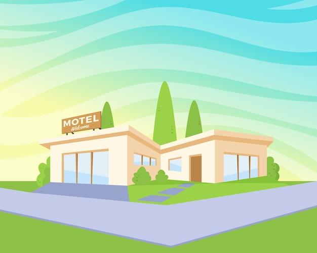 Motel de arquitetura com gramado verde e árvores.